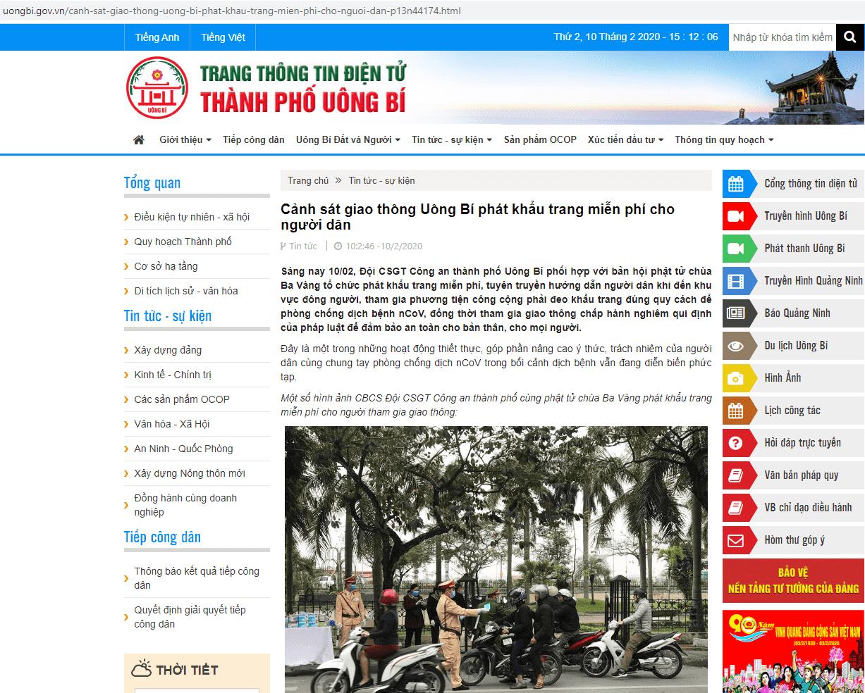 Hình ảnh trên trang thông tin điện tử thành phố Uông Bí đưa tin Cảnh sát giao thông kết hợp với Phật tử chùa Ba Vàng phát khẩu trang miễn phí